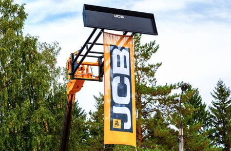 Samara, Russia - September 15, 2019: Dealership flag JCB Tractor at the annual Volga agro-industrial exhibition