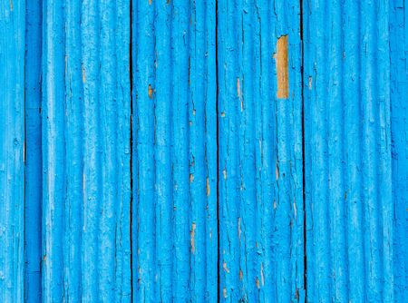 Old rough wooden boards with cracks as background. Wooden planks texture with the shabby blue paint Stock Photo
