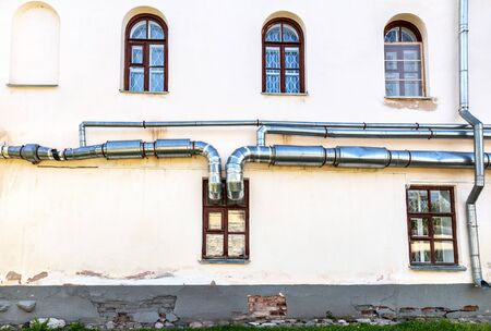 Metal pipes of ventilation system on the wall of building Reklamní fotografie