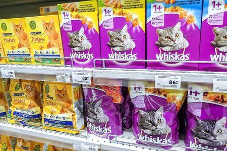 Samara, Russia - December 21, 2019: Various fresh cat food ready for sale on supermarket shelves. Cat food as background Editöryel