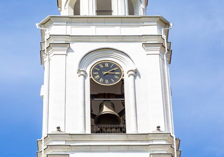 Russian orthodox church. Fragment of bell tower of the Iversky monastery with bell and chime clock in Samara, Russia