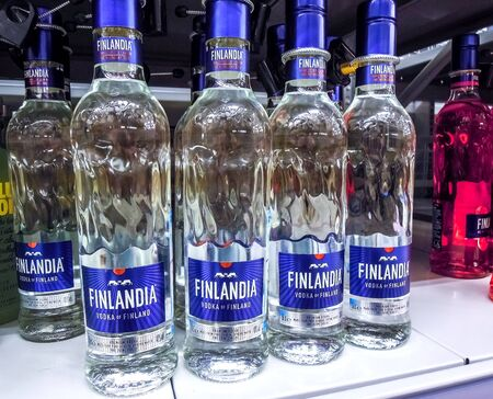 Samara, Russia - January 12, 2020: Finlandia vodka of finland ready for sale on the shelf in superstore. Various bottled alcoholic beverages