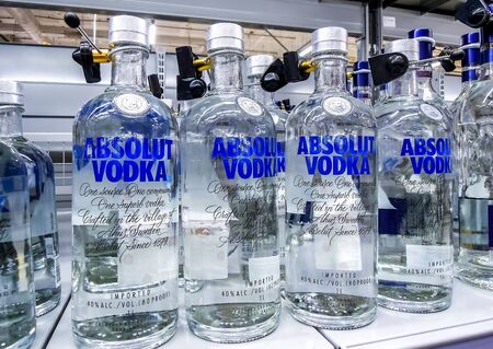 Samara, Russia - January 12, 2020: Absolut Vodka ready for sale on the shelf in superstore. Swedish brand of vodka is popular in Russia and all over the world. Various bottled alcoholic beverages