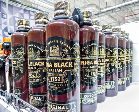 Samara, Russia - January 12, 2020: Riga Black Balsam is a traditional Latvian herbal liqueur ready for sale on the shelf in superstore. Various bottled alcoholic beverages 新聞圖片