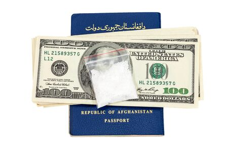 Package with drug over the Afghanistan passport and american dollars isolated on white