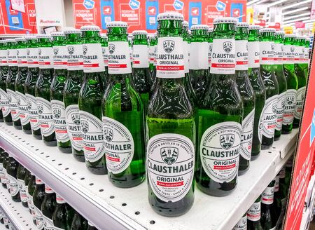 Samara, Russia - February 1, 2020: Clausthaler non alcoholic beer ready for sale on the shelf in superstore. Various bottled alcoholic beverages and spirit drinks Editorial