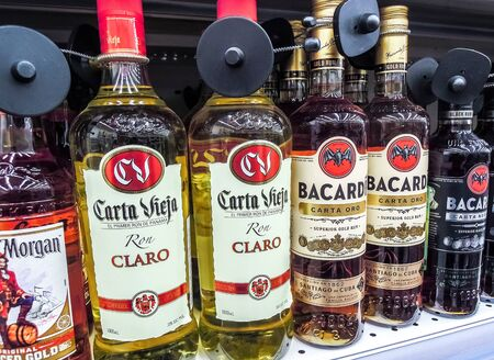 Samara, Russia - February 1, 2020: Bacardi rum ready for sale on the shelf in superstore. Various bottled alcoholic beverages