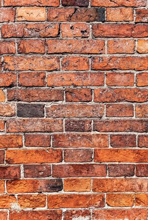 Red brick wall as background texture. Bricks masonry with uneven seams Stock fotó