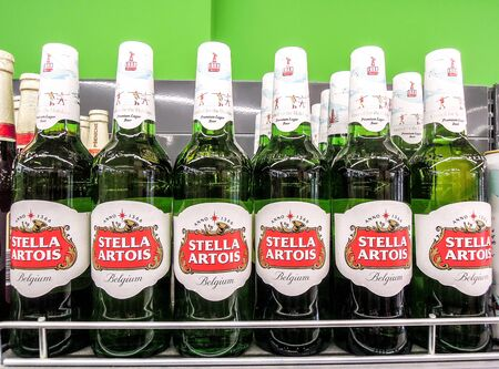 Samara, Russia - February 23, 2020: Stella Artois alcoholic beer ready for sale on the shelf in superstore. Various bottled alcoholic beverages and spirit drinks