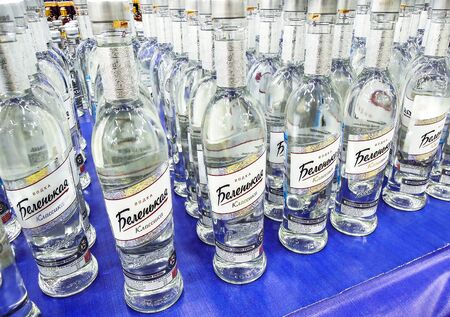 Samara, Russia - February 22, 2020: Russian Belenkaya vodka ready for sale on the shelf in superstore. Various bottled alcoholic beverages and spirit drinks