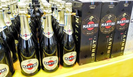 Samara, Russia - March 7, 2020: Bottled alcoholic sparkling beverages Martini ready for sale on the shelf in superstore. Various bottled alcoholic beverages and spirit drinks