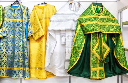 Different solemn colorful orthodox priest's robes, clergyman's embroidered robe. Russian Orthodox Church Stock Photo
