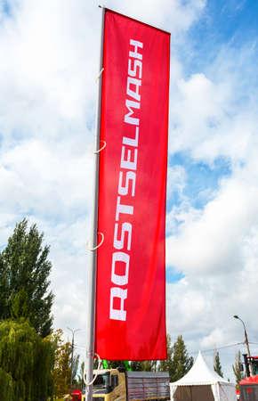 Samara, Russia - September 15, 2019: Dealership flag Rostselmash company against the sky at the annual Volga agro-industrial exhibition Publikacyjne