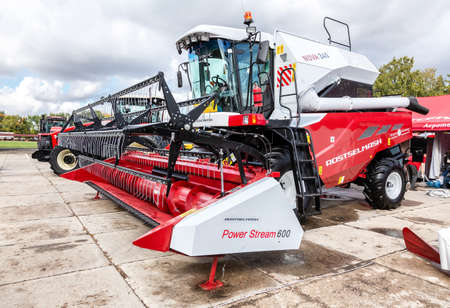 Samara, Russia - September 15, 2019: Modern agricultural machinery. Combine-harvester Rostselmash Nova 340 with reaping Power Stream 600