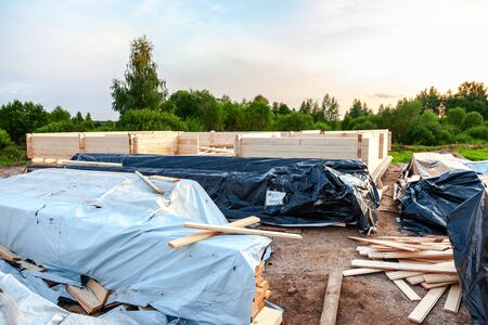 Construction of a new wooden house on the stone foundation