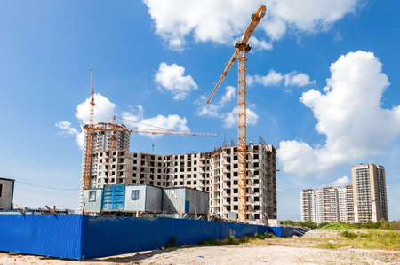 St. Petersburg,  Russia - July 28, 2016: Skyscrepers buildings under construction with cranes against a blue sky background