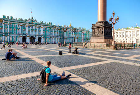 St. Petersburg,  Russia - July 27, 2016: People have a rest on Palace Square on a summer sunny day Editorial