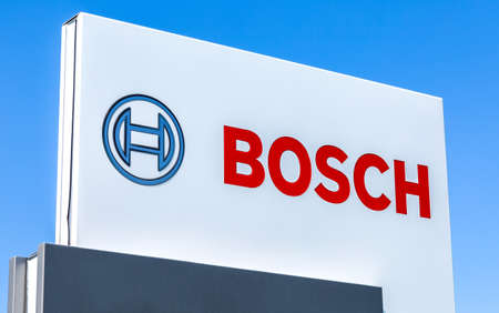 Samara, Russia - May 14, 2020: Signboard with emblem Bosch  against the blue sky. Bosch is a multinational engineering and electronics company