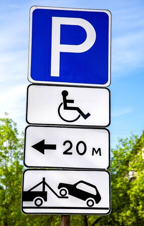 Road sign Parking place for the disabled against the blue sky. Handicapped parking
