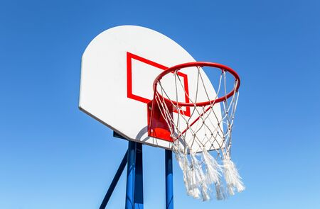 Basketball backboard against the blue sky