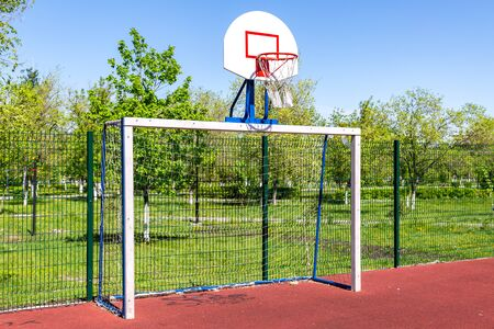 Basketball backboard on the sportground in summer sunny day