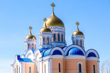 Golden domes of orthodox cathedral against the blue sky