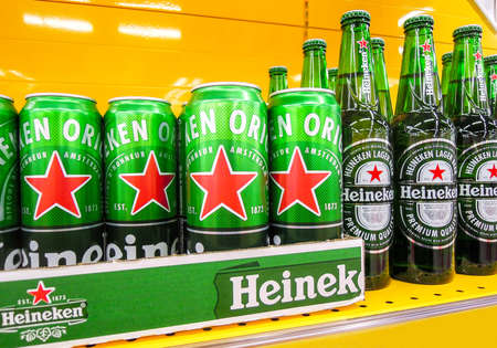 Samara, Russia - March 18, 2020: Heineken alcoholic beer ready for sale on the shelf in superstore. Various bottled alcoholic beverages and spirit drinks Editorial