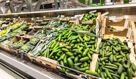 Samara, Russia - June 1, 2019: Fresh cucumbers ready for sale in superstore Editorial