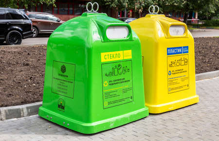 Moscow, Russia - July 7, 2019: Separation bin according to waste type. Separate garbage containers on city street