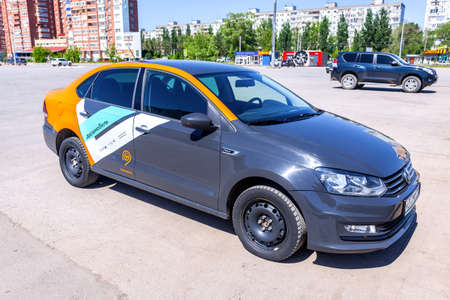 Samara, Russia - May 29, 2020: Car sharing Delimobil car parked in the city street. Rent a car of various brands. Carsharing service vehicle Editorial