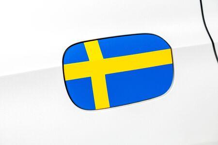 Swedish flag on a car gas tank hatch close up Stock Photo