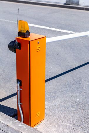 Automatic rising arm barrier for entry or stop traffic. Boom barrier gate acces entry Stock Photo