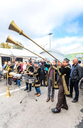 Samara, Russia - October 5, 2019: Uzbek ethnic musicians playing on musical folk instruments on the holidays Editorial