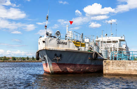 Shlisselburg, Russia - August 8, 2018: Ship is at the quay wall of the river port in summer sunny day