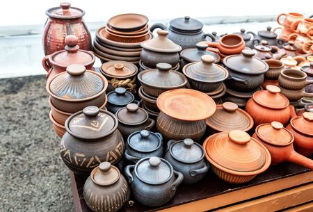 Ceramic dishes, tableware and pots sold on the market close up Stock Photo