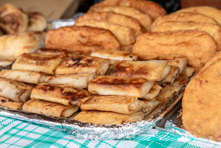 Fresh appetizing delicious fried pies and filling pancakes
