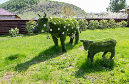 Shiryaevo, Russia - May 15, 2019: Decorative composition Cow and Ð¡alf at the outdoors