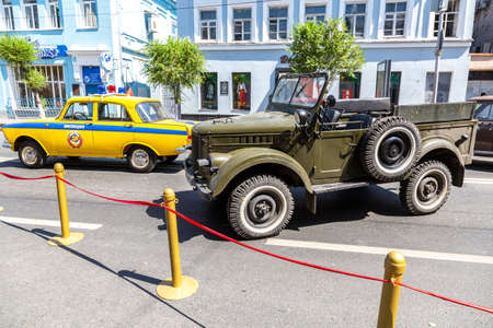 Samara, Russia - June 12, 2019: Vintage Soviet police automobile Moskvich 412 and off-road vehicle GAZ 69 parked up at the city street