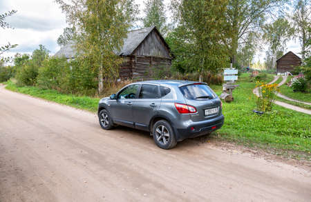 Novgorod region, Russia - September 15, 2020: Nissan Qashqai vehicle at the countryside. Text in Russian: milk, curd Editorial