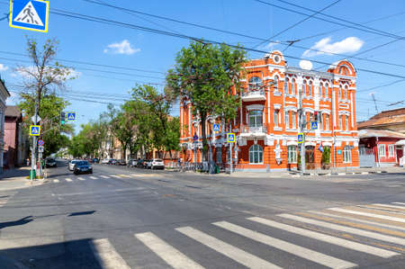 Samara, Russia - June 12, 2019: City street with cars and tram way in summer sunny day
