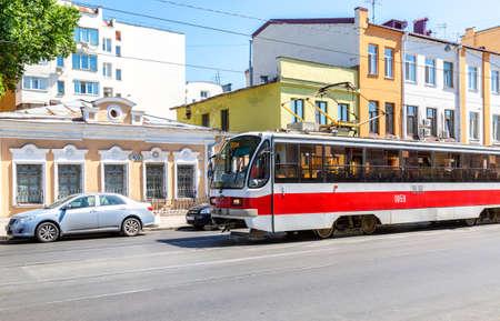Samara, Russia - June 12, 2019: Russian public transport. Tram runs on the city street in summer sunny day