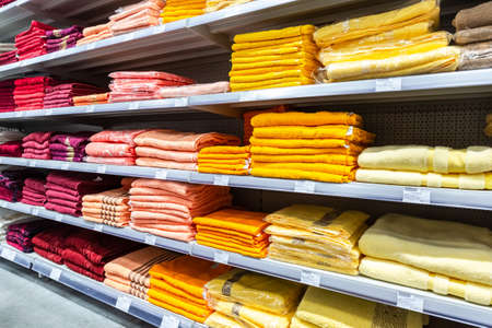 Samara, Russia - March 31, 2019: Various colored towels ready to sale on the shelves at the superstor Editorial