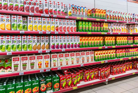 Samara, Russia - March 31, 2019: Various packaged fresh juice ready for sale in the superstore
