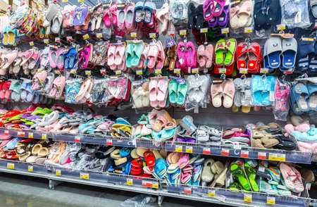 Samara, Russia - April 7, 2019: Various colorful slippers selling at the showcase in chain hypermarket Sajtókép