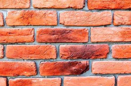 Red brick wall texture as creative background. Bricks masonry with seams