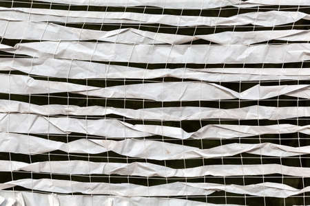 Abstract background of white camouflage net close up