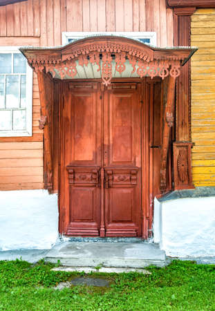 Old wooden door with traditional carved patterns