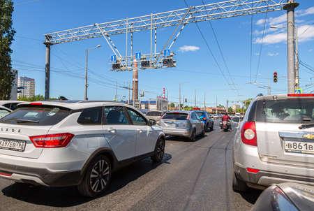 Samara, Russia - June 18, 2021: Cars drive along city street with multi-lane traffic in summer Editorial