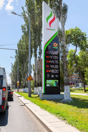 Samara, Russia - June 18, 2021: Guide sign, indicated the price of the fuel with logo of the oil company Tatneft. Tatneft is one of the Russian oil companies