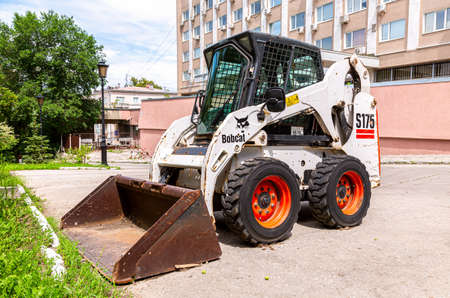 Samara, Russia - June 14, 2021: Bobcat loader vehicle at the city street. Bobcat Company is an American-based manufacturer of farm and construction equipment